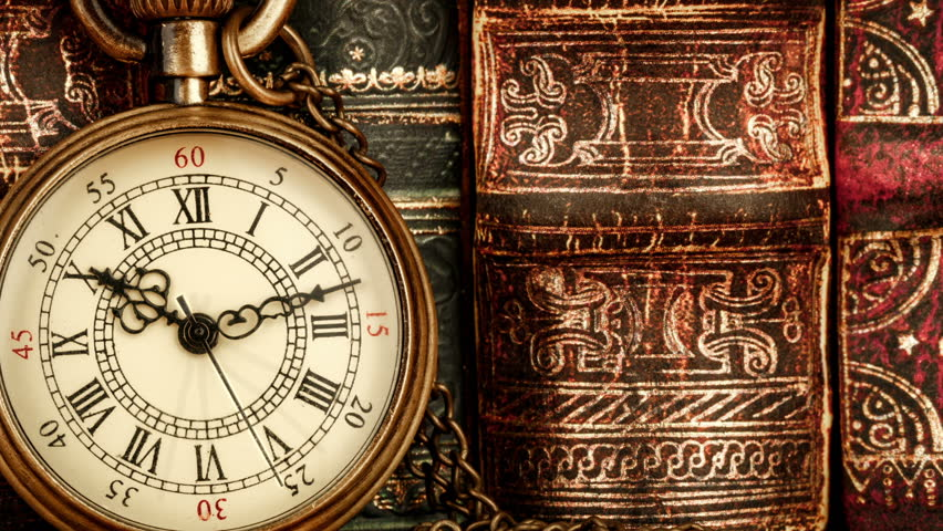 Vintage magnifying glass compass telescope and a pocket watch vintage antique pocket watch against the background of old books hd stock footage clip gumiabroncs Choice Image