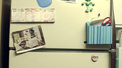Student posting grade on refrigerator.