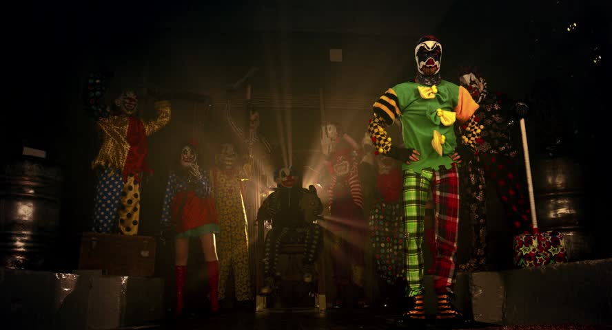 Party of clowns. Clowns dancing and intimidating weapons. Halloween.   Shutterstock HD Video #12106676