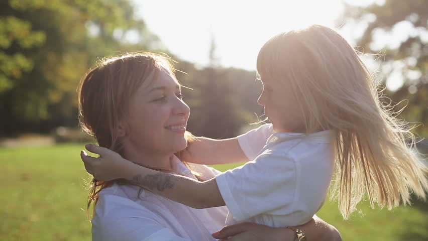 Mother with daughter hugging and kissing at nature at sunset  | Shutterstock HD Video #12110666
