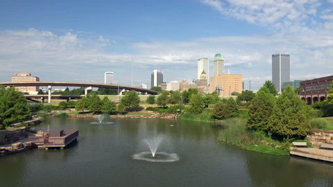 Tulsa, Oklahoma, USA - August 14, 2015: Downtown Tulsa, Oklahoma with park fountains in the foreground on a sunny day.