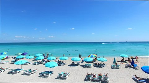 Aerial 4K video of South Beach, Miami Beach. Amazing bird's view on most famous beach in the World and Collins Park.