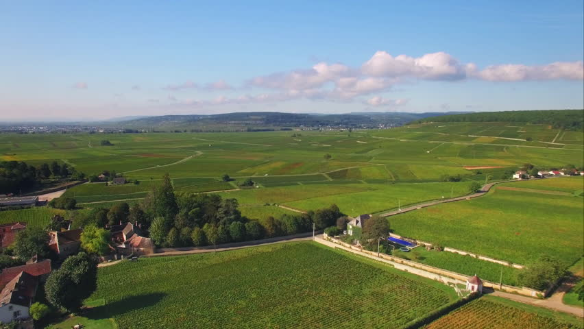 Lovely french village aerial shot / European country side drone shot, surrounded by nature