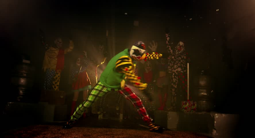 A group of clowns. Two clown acrobat dance break dance. Halloween party.