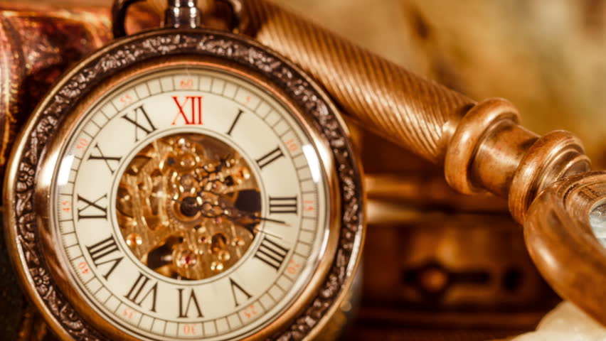 Vintage magnifying glass compass telescope and a pocket watch vintage antique pocket watch against the background of old books hd stock video clip gumiabroncs Choice Image
