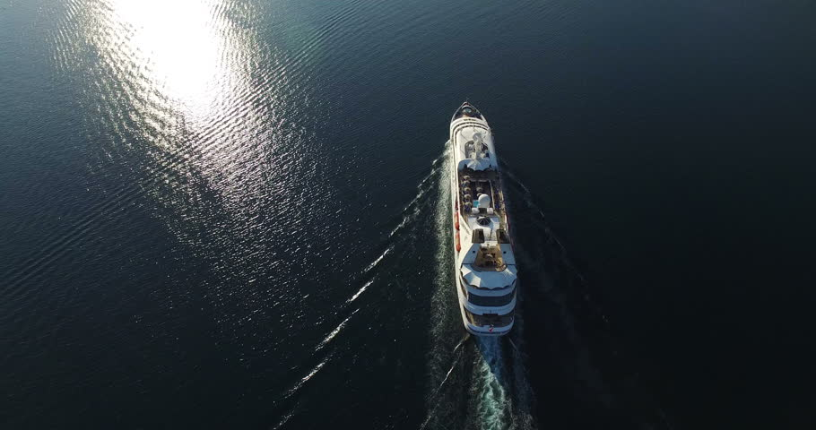 Aerial view of luxury medium cruise ship sailing from port on sunrise through the bay | Shutterstock HD Video #12161849