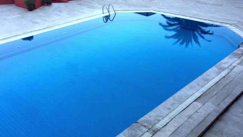 outside the hotel swimming pool aerial hd stock footage clip - Rectangle Pool Aerial View