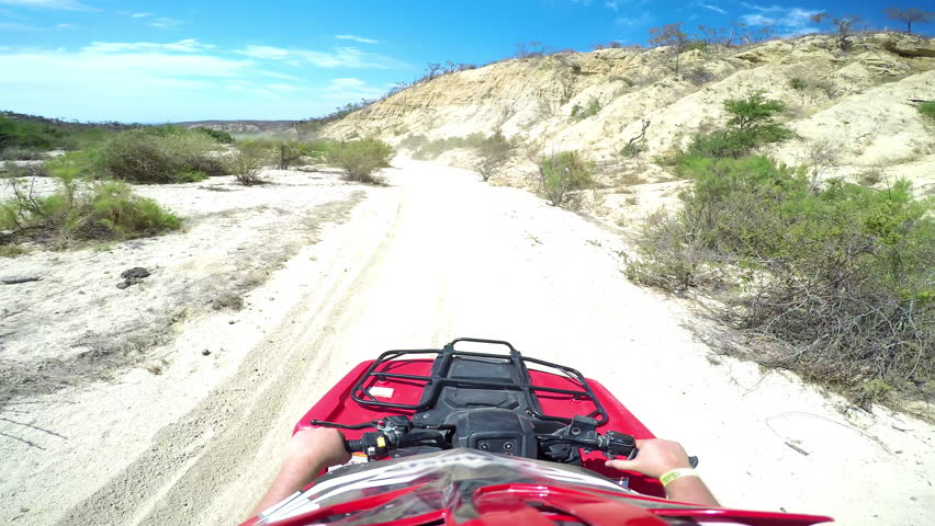 First person POV of a four wheeler driving on trails at the coast | Shutterstock HD Video #12179042