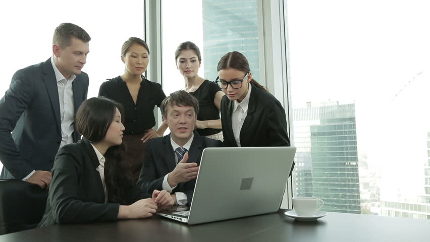 A young promising team of businessmen discuss the results and rejoice in the success, Dolly shot | Shutterstock HD Video #12187292