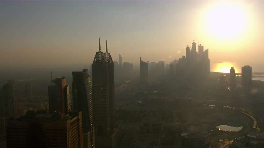 WS AERIAL View of Dubai city and sky scrapper at sunset / Dubai, United Arab Emirates | Shutterstock HD Video #12212834