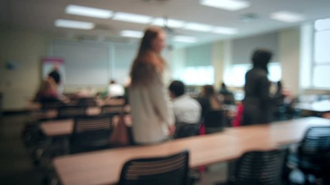 Back to School concept with Students Entering into a Blurred Classroom