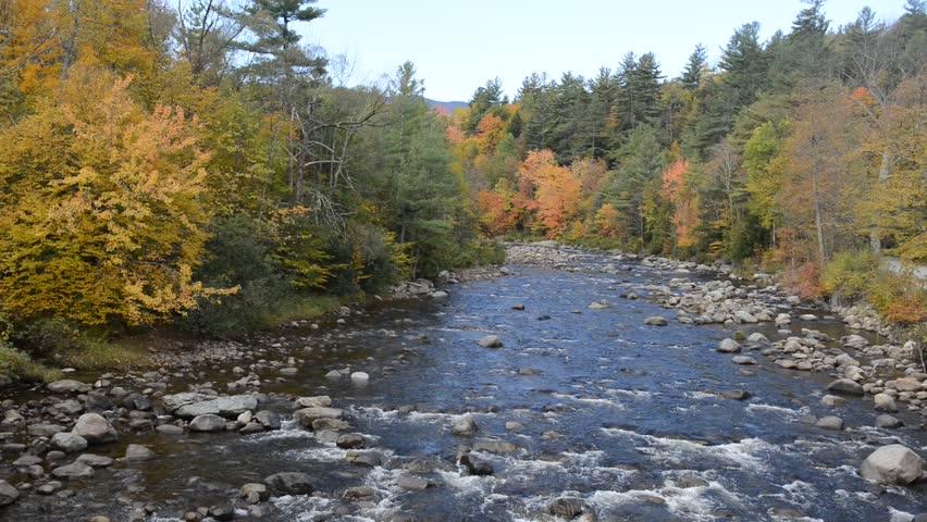 Fall foliage over water in the Adirondacks, New York