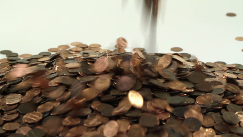 Pennies falling on to a white background