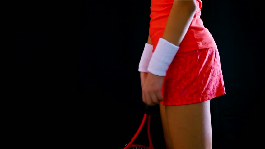 The body of a girl tennis player expecting serving on a black background | Shutterstock HD Video #12284876
