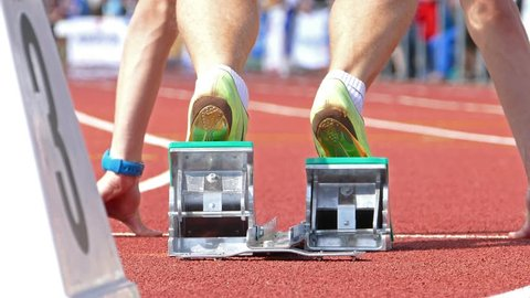 Low perspective clip of a runner, starting out of the block.