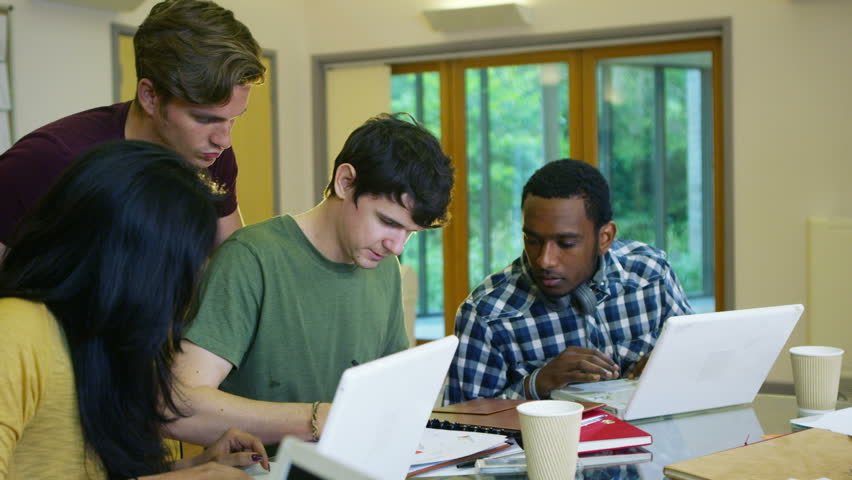 4K Mixed ethnicity student group working together in college. Shot on RED Epic. | Shutterstock HD Video #12342296