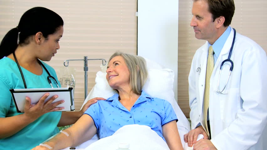 Caucasian male female elderly patient medical clinical hospital consultant Hispanic nurse wireless tablet technology healthcare diagnosis | Shutterstock HD Video #12354767