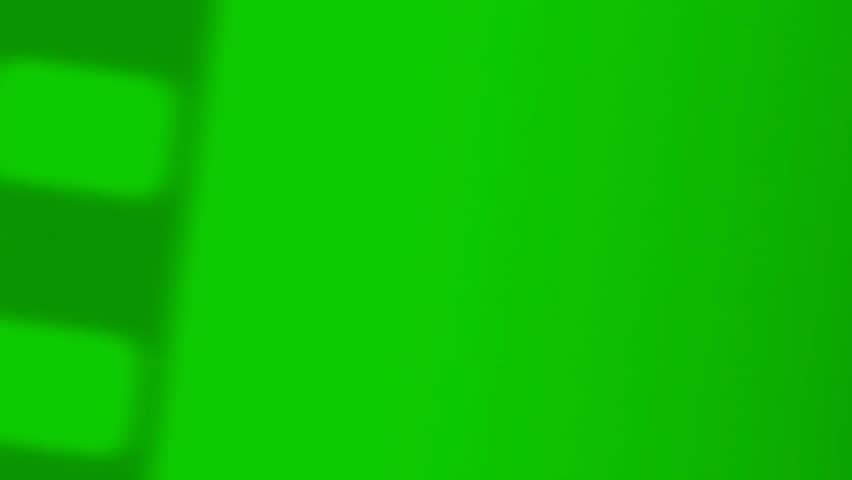Old 8mm Film Reel Effect on a Green Screen Background