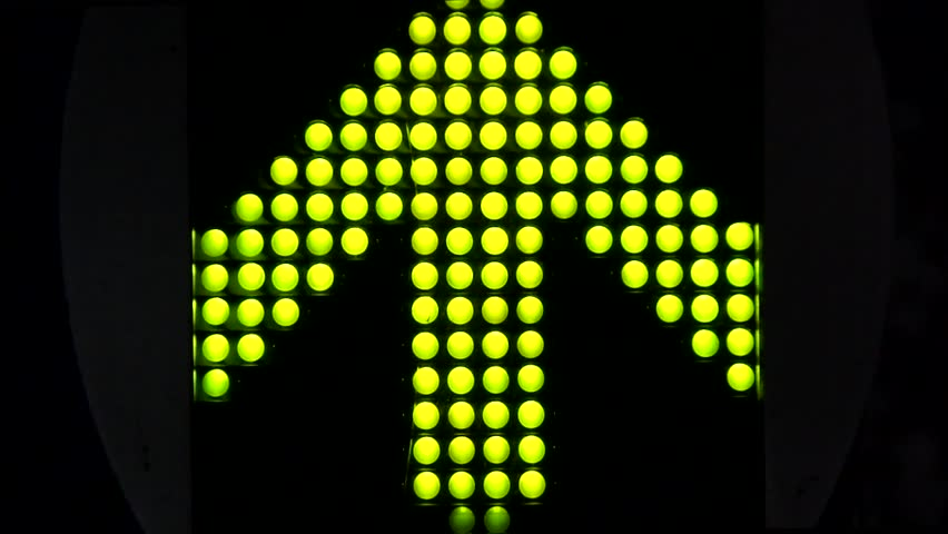 Green LED light arrow pointing up and moving fast upwards large arrow exists of 120 smaller LED lamps all moving by blinking turning on turning off black dark background fast moving lights up signal | Shutterstock HD Video #12366647