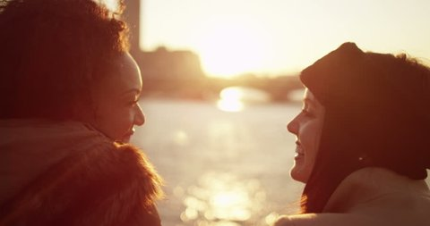 Attractive young couple at Millennium bridge watching the sunset over London