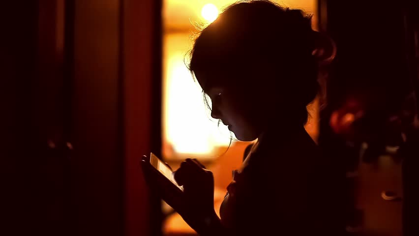 Girl looking game smartphone on the internet in the corridor girl looking game smartphone on the internet in the corridor indoor yellow brown silhouette stock footage video 12396776 shutterstock sciox Image collections