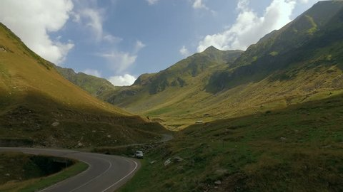 4K aerial shot of Fagaras Mountains crossed by Transfagarasan – one of the highest altitude mountain roads in Romania