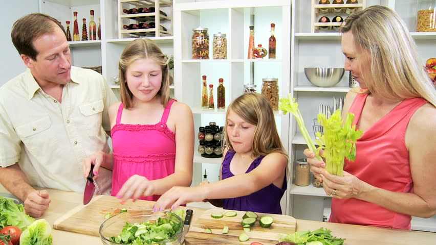 Home Kitchen Cooking healthy blonde caucasian family cooking home kitchen - happy