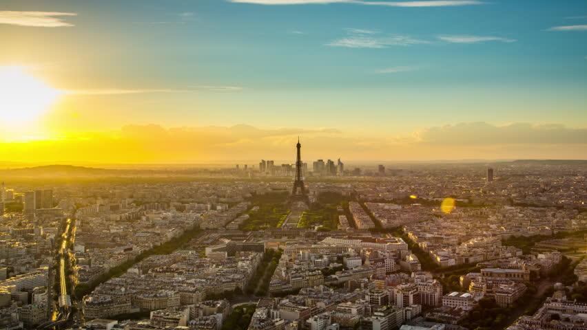 Paris - August 3rd, 2013: Time lapse footage of sunset over Eiffel Tower seen from Tour Montparnasse (Montparnasse 56), Paris, France | Shutterstock HD Video #12433106