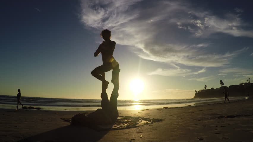 Beach sunset acroyoga routine 60fps. Silhouette beauty shot. | Shutterstock HD Video #12454493