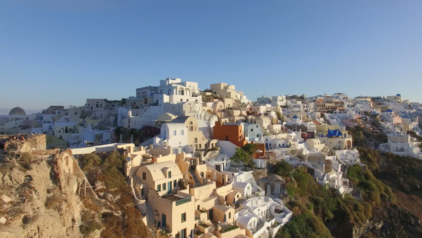 Aerial view flying over city of OIa on Santorini Greece 4K