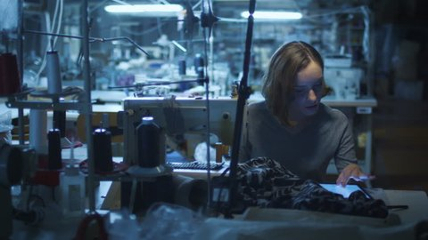 Timelapse of employees working at a clothing factory. Shot on RED Cinema Camera in 4K (UHD).