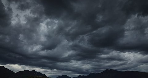 Darkness dramatic sky over the mountains, floating clouds, time lapse 4k video