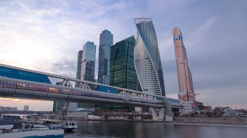 Skyscrapers International Business Center City at night with Moscow river and Bagration bridge day to night transition timelapse hyperlapse, Moscow, Russia 4K