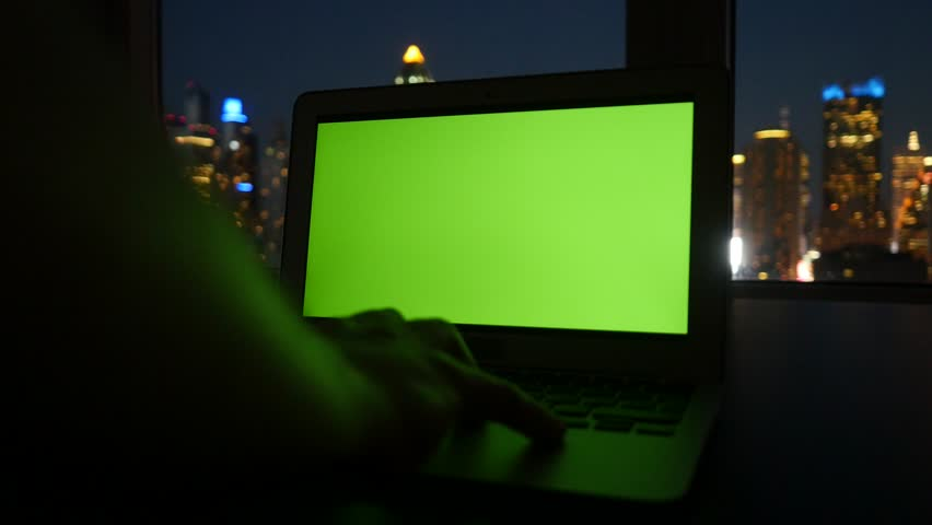 Laptop with isolated green screen. urban city background. modern computer technology. tracking dolly shot  | Shutterstock HD Video #12549434
