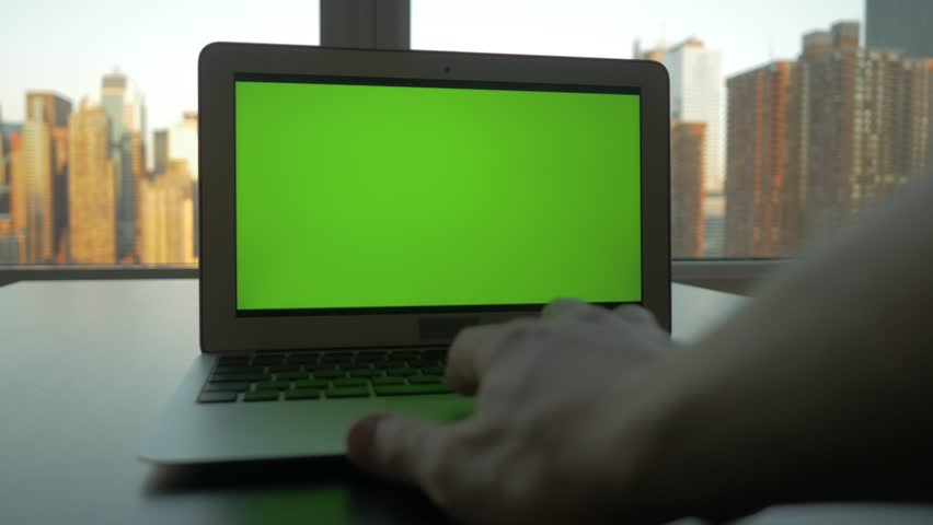 Laptop desk view in modern business office. city skyline background. computer screen  isolated with green screen | Shutterstock HD Video #12549500