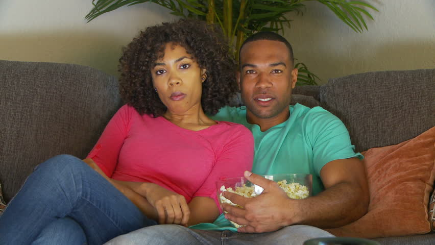 Couple watching scary movie on couch | Shutterstock HD Video #1258216