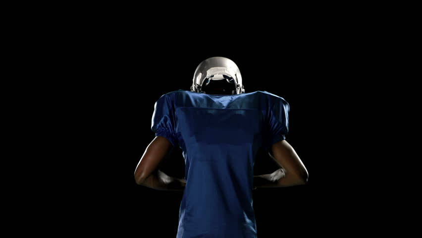 Us Football Background: Stock Video Of American Football Player On Black