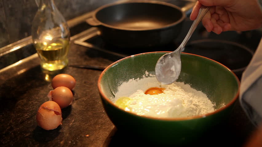 Cook mixes kefir clabber with flour and eggs making dough for a footage of a woman preparing dough for making pancakes a process of flour ccuart Image collections