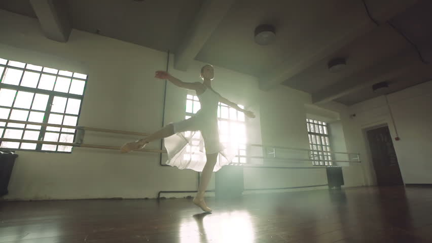Graceful girl practicing ballet in the Studio, slow motion , performs the elements of dance | Shutterstock HD Video #12676496
