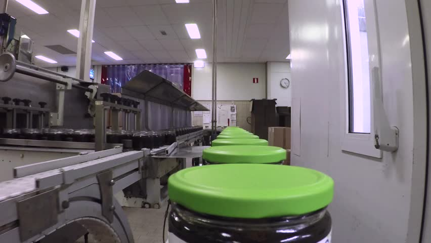 Syrup jars on a production line | Shutterstock HD Video #12692936