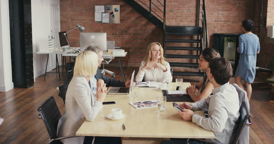 Multi-ethnic business team meeting involved diverse people participating in creative sustainable ideas steadicam shot across boardroom table shared work space | Shutterstock HD Video #12720473