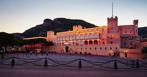 MONACO, MONACO VILLE, 05.09.2015: Prince's palace of Monaco at sunset, rock background, many tourists, nights illumination