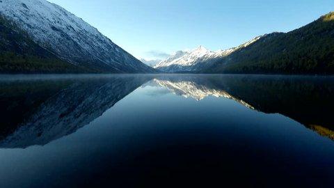 4K UHD Aerial Footage Above Foggy Mountain Lake at Morning