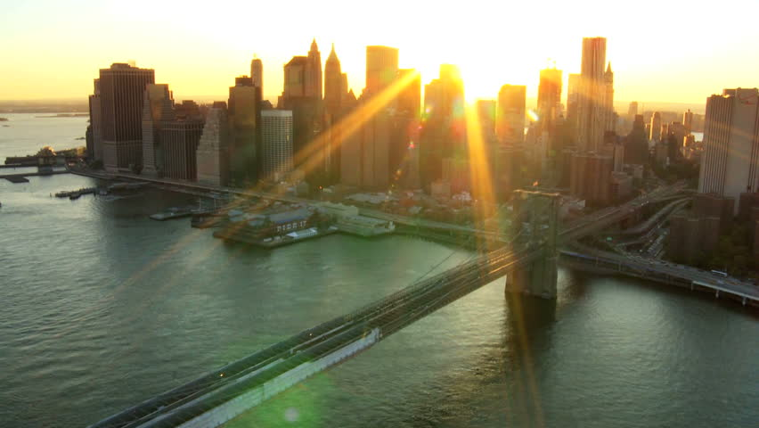 Aerial view of New York Financial District of Manhattan, Brooklyn Bridge and the Hudson River at Sunset, North America, USA