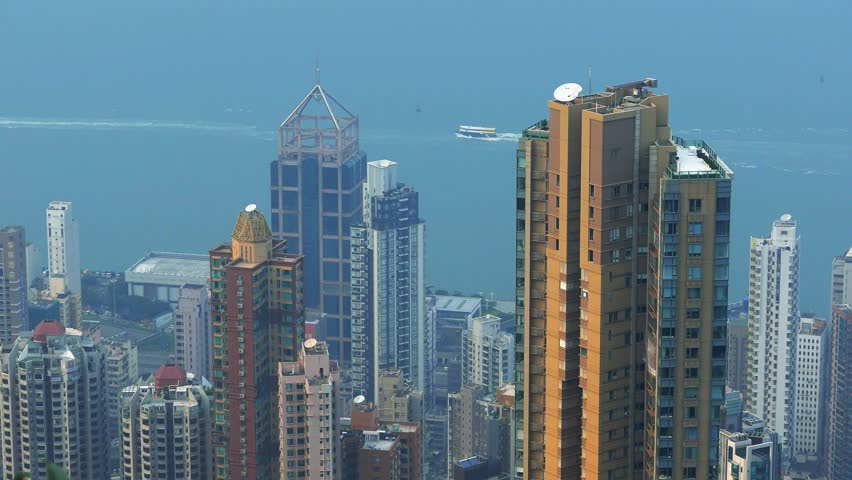 Aerial view of Hong Kong with boats on the background. Static shot. Color graded. Visit my portfolio for Cinelike D flat picture profile version. | Shutterstock HD Video #12805406