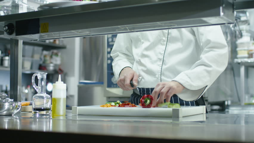 Restaurant Kitchen Video professional chef in a commercial kitchen in a restaurant or hotel