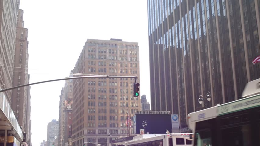 NEW YORK - AUG 25, 2014: Street and modern high buildings. Population of NYC is 8,4 mln people | Shutterstock HD Video #12824336