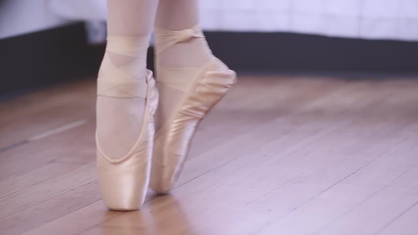 a ballerina in pointe shoes