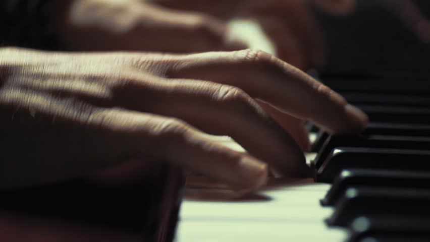 A very close look at a jazz pianist's hands.