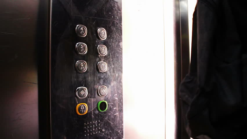 people inside elevator. people inside the elevator, press button with a choice of floor and ride in elevator